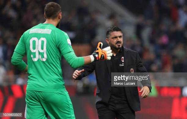 Milan coach Gennaro Gattuso celebrates victory with Gianluigi Donnarumma at the end of the serie A match between AC Milan and AS Roma at Stadio...