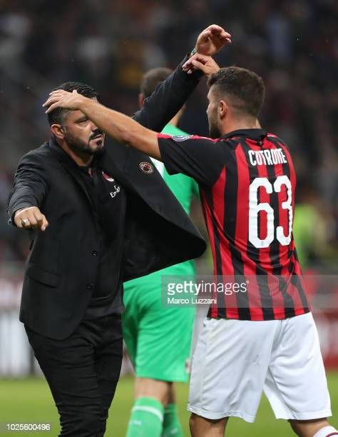Milan coach Gennaro Gattuso celebrates victory with Patrick Cutrone at the end of the serie A match between AC Milan and AS Roma at Stadio Giuseppe...