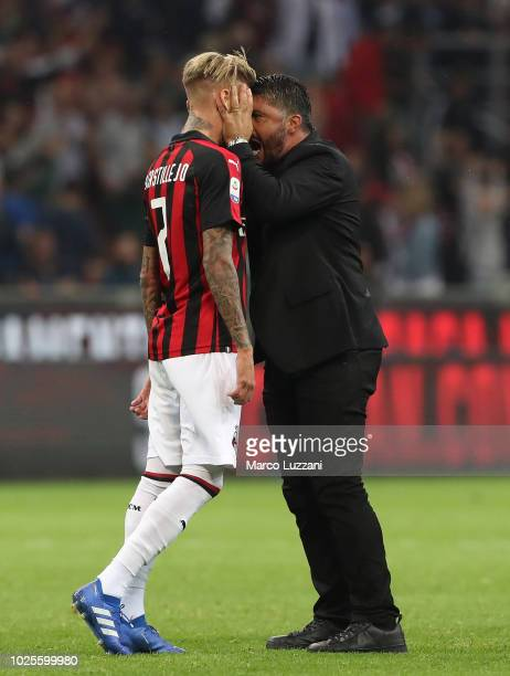 Milan coach Gennaro Gattuso celebrates victory with Samuel Castillejo at the end of the serie A match between AC Milan and AS Roma at Stadio Giuseppe...