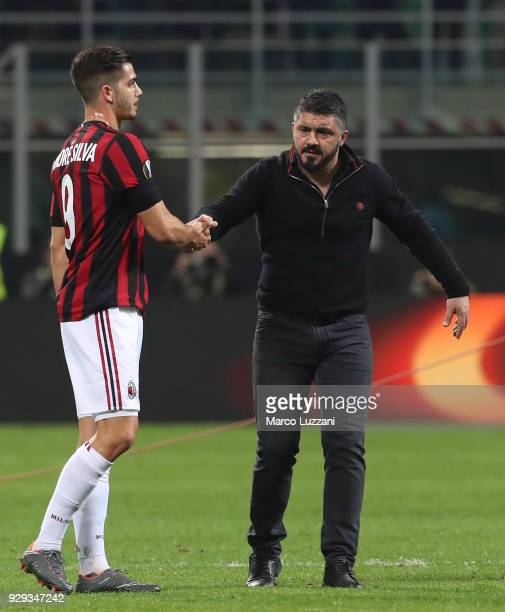 Milan coach Gennaro Gattuso shakes hands with Andre Silva of AC Milan at the end of during UEFA Europa League Round of 16 match between AC Milan and...