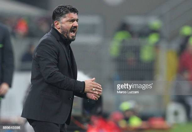 Milan coach Gennaro Gattusoshouts to his players during the Serie A match between AC Milan and Bologna FC at Stadio Giuseppe Meazza on December 10...