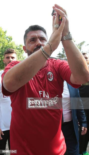 Milan coach Ivan Gennaro Gattuso greets the fans prior to the AC Milan training session at the club's training ground Milanello on July 9 2018 in...