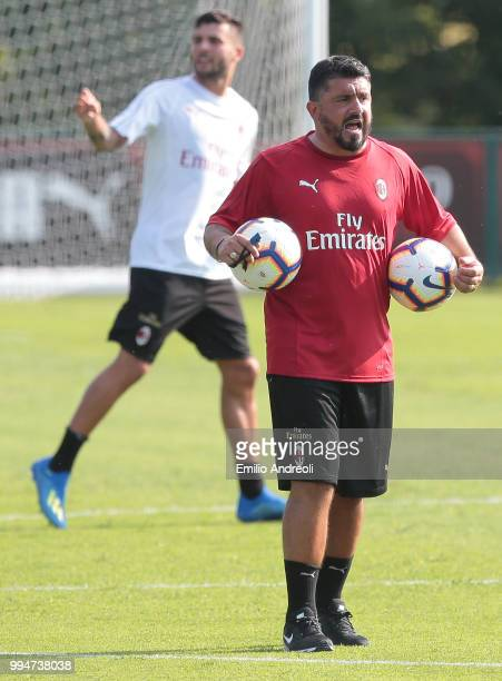 Milan coach Ivan Gennaro Gattuso shouts to his players during the AC Milan training session at the club's training ground Milanello on July 9 2018 in...