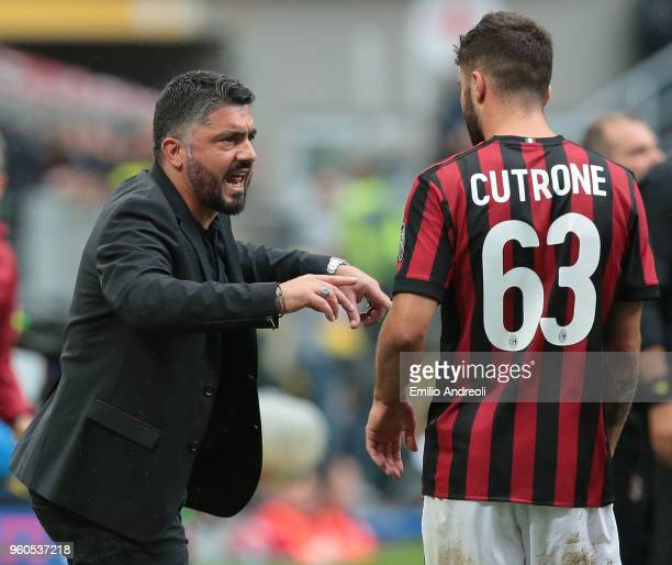 Milan coach Ivan Gennaro Gattuso speaks with Patrick Cutrone during the serie A match between AC Milan and ACF Fiorentina at Stadio Giuseppe Meazza...