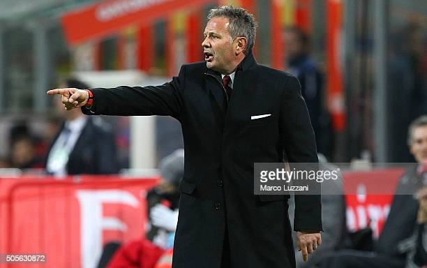 Milan coach Sinisa Mihajlovic issues instructions to his players during the TIM Cup match between AC Milan and Carpi FC at Stadio Giuseppe Meazza on...