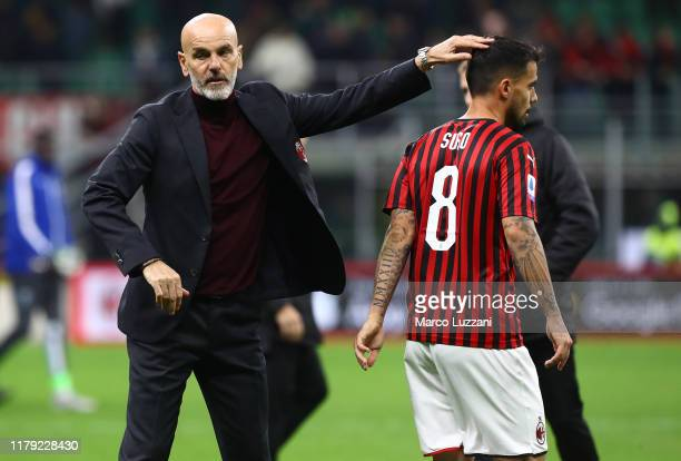 Milan coach Stefano Pioli and Fernandez Suso celebrate a victory at the end of the Serie A match between AC Milan and SPAL at Stadio Giuseppe Meazza...