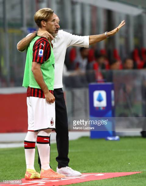 Milan coach Stefano Pioli issues instructions to his player Lucas Biglia during the Serie A match between AC Milan and Bologna FC at Stadio Giuseppe...