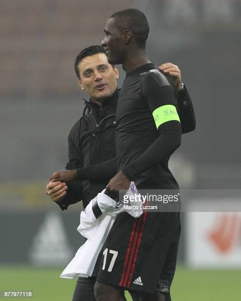 Milan coach Vincenzo Montella embraces Cristian Zapata at the end of the UEFA Europa League group D match between AC Milan and Austria Wien at Stadio...