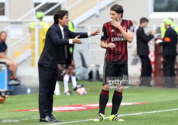 Milan coach Vincenzo Montella issues instructions to his player Riccardo Montolivo during the Serie A match between AC Milan and Udinese Calcio at...