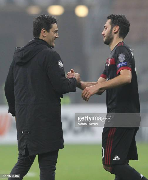 Milan coach Vincenzo Montella shakes hands with his player Hakan Calhanoglu at the end of the UEFA Europa League group D match between AC Milan and...