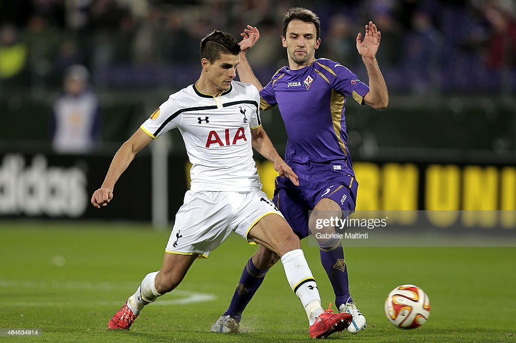 Milan Dabelj of ACF Fiorentina battles for the ball with Erik Lamela of Tottenham Hotspur FC during the UEFA Europa League Round of 32 match between ACF Fiorentina and Tottenham Hotspur FC at Artemio Franchi stadium on February 26, 2015 in Florence, Italy.