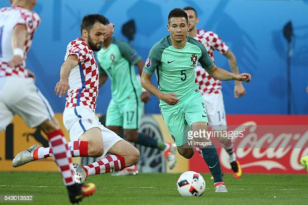 Milan Dadelj of Croatia Raphael Guerreiro of Portugal during the UEFA Euro 2016 round of 16 match between Croatia and Portugal on June 25 2016 at the...