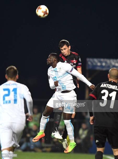 AC Milan defender Alessio Romagnoli vies with Rijeka's forward Maxwell Acosty during the UEFA Europa League Group D football match between HNK Rijeka...