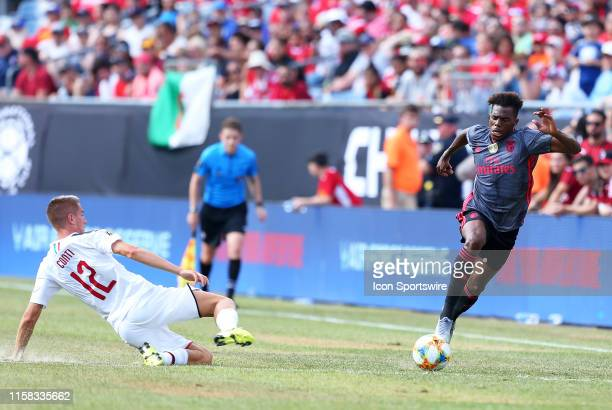 Milan defender Andrea Conti and SL Benfica defender Nuno Tavares in action during the international friendly match between AC Milan and SL Benfica on...