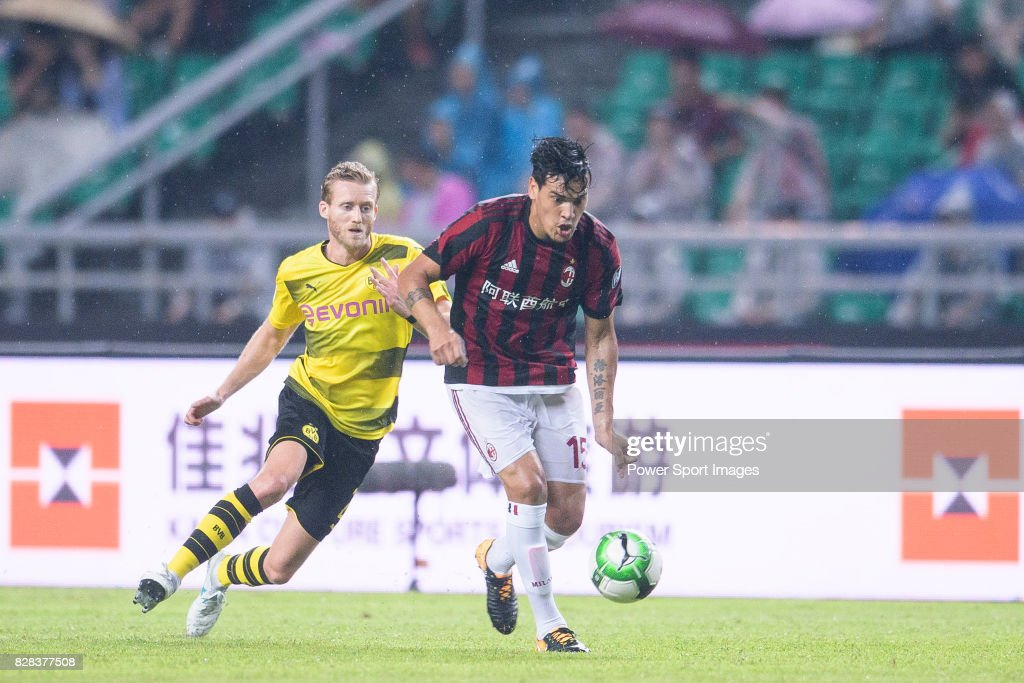 AC Milan Defender Gustavo Gomez (R) dribbles Borussia Dortmund Midfielder Andre Schurrle (L) in action during the International Champions Cup 2017 match between AC Milan vs Borussia Dortmund at University Town Sports Centre Stadium on July 18, 2017 in Guangzhou, China.