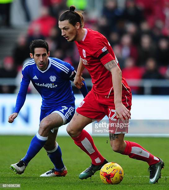 Milan Djuric of Bristol City is challenged by Peter Whittingham of Cardiff City during the Sky Bet Championship match between Bristol City and...