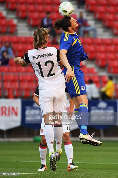 Milan Duric of Bosnia and Herzegovina and Jannik Vestergaard of Denmark compete for the ball during the international friendly match between Bosnia...