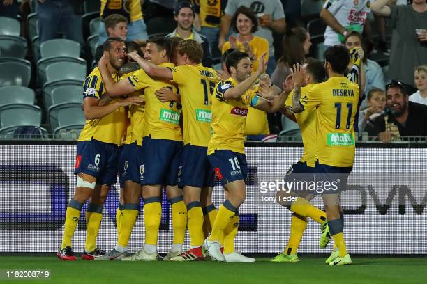 Milan Duric of the Central Coast Mariners celebrates a goal with team mates during the round two ALeague match between the Central Coast Mariners and...