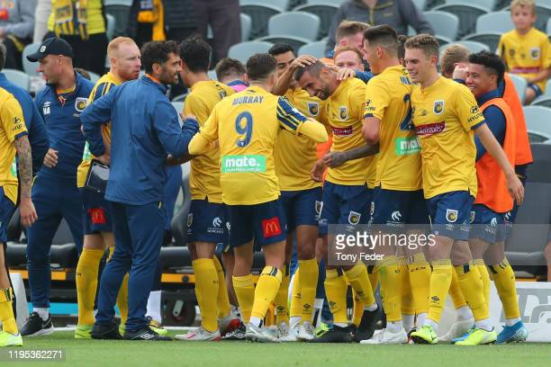 Milan Duric of the Central Coast Mariners celebrates a goal with team mates during the round 11 ALeague match between the Central Coast Mariners and...