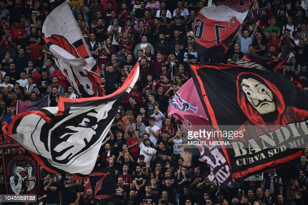 AC Milan fans cheer during the Europa League Group F football match between AC Milan and Olympiakos at the San Siro stadium on October 4 2018 in Milan