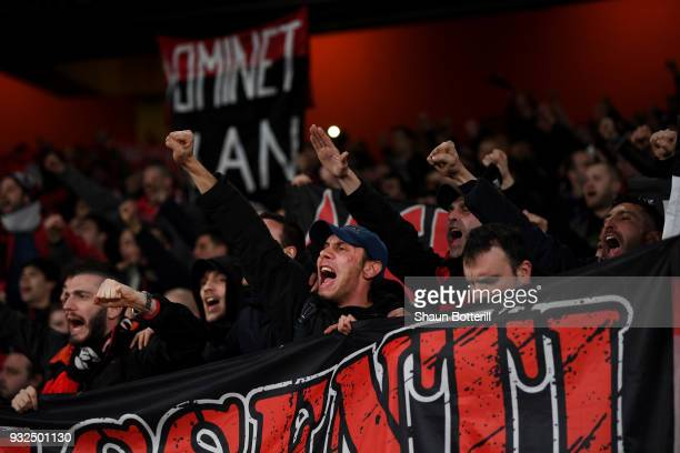 Milan Fans sing prior to the UEFA Europa League Round of 16 Second Leg match between Arsenal and AC Milan at Emirates Stadium on March 15 2018 in...