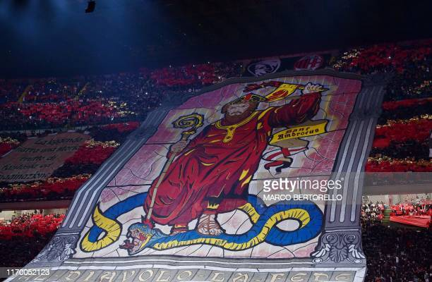 AC Milan fans unfold a giant tifo during the Italian Serie A football match AC Milan vs Inter Milan on September 21 2019 at the San Siro stadium in...