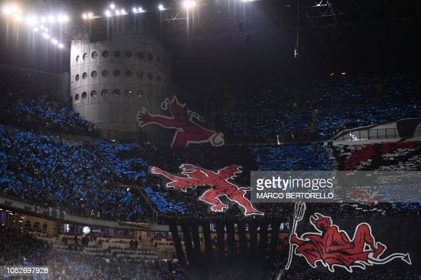 AC Milan fans unfold giant red devils prior to the Italian Serie A football match Inter Milan vs AC Milan on October 21 2018 at the San Siro stadium...