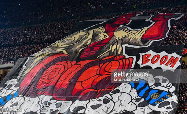 Milan fans unfurl a giant tifo during the Italian Serie A football match AC Milan vs Inter Milan at the San Siro stadium in Milan on March 17 2019