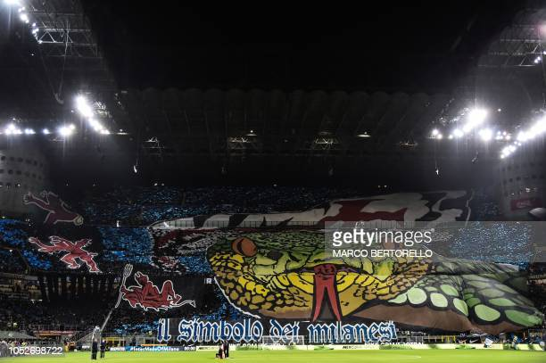 AC Milan fans unfurl giant tifos prior to the Italian Serie A football match Inter Milan vs AC Milan on October 21 2018 at the San Siro stadium in...