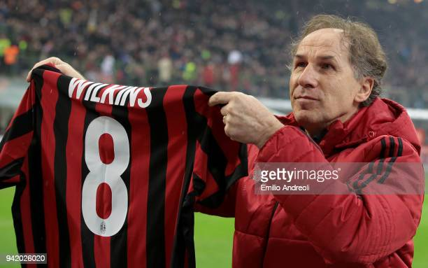 Milan former player Franco Baresi shows the shirt of Ray Wilkins before the serie A match between AC Milan and FC Internazionale at Stadio Giuseppe...