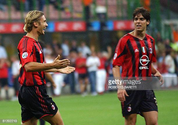 Milan forward Andriy Shevchenko of Ukraine celebrates after scoring against Lazio with Brazilian teammate Kaka in an Italian SuperCup final match at...