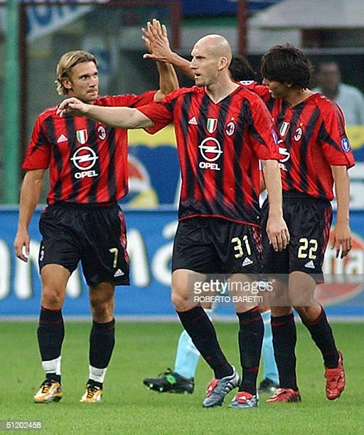 Milan forward Andriy Shevchenko of Ukraine celebrates after scoring against Lazio with Dutch teammates Jaap Stam and Brazilian Kaka in the Italian...