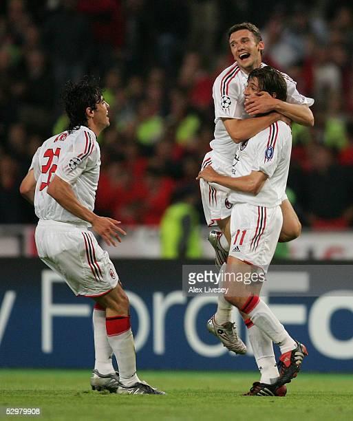 Milan forward Andriy Shevchenko of Ukraine celebrates with AC Milan forward Hernan Crespo of Argentina and AC Milan forward Ricardo Kaka of Brazil...