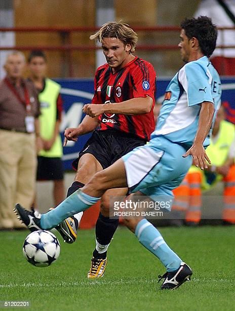 Milan forward Andriy Shevchenko of Ukraine challenges Lazio defender Oscar Lopez of Spain in an Italian SuperCup final match at San Siro Stadium in...