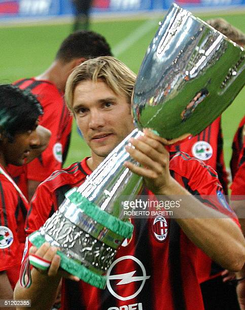 Milan forward Andriy Shevchenko of Ukraine holds the trophy after winning the Italian SuperCup final match over Italian club Lazio at San Siro...