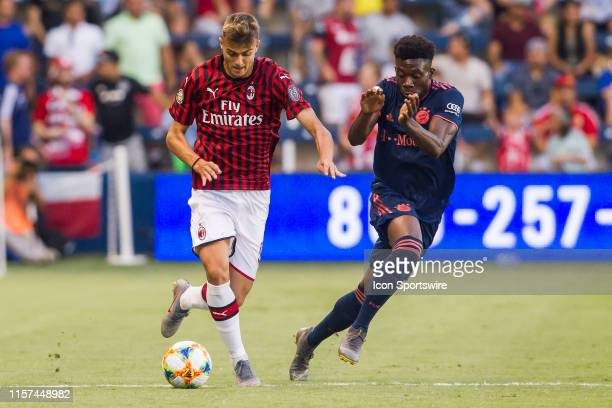 Milan forward Daniel Maldini attempts to drive the ball past Bayern Munich forward Alphonso Davies during the match between FC Bayern and AC Milan on...