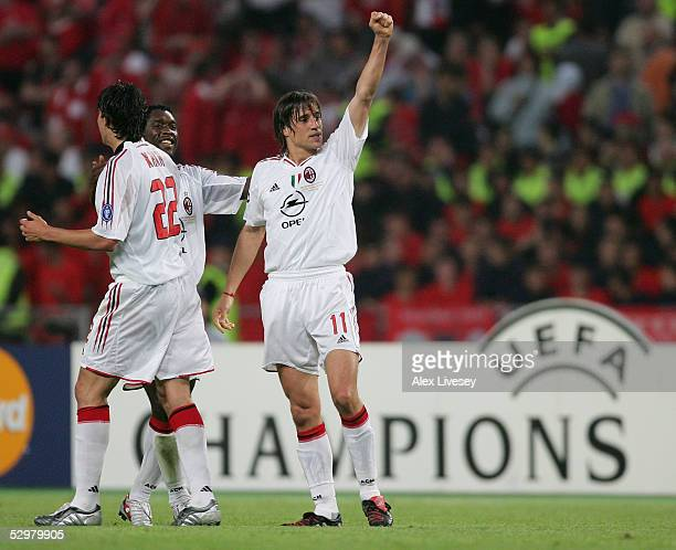 Milan forward Hernan Crespo of Argentina celebrates with AC Milan forward Ricardo Kaka of Brazil and AC Milan midfielder Clarence Seedorf of the...
