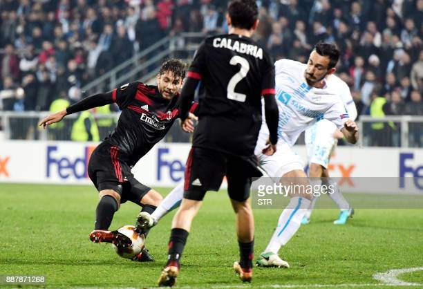 AC Milan forward Manuel Locatelli fights for the ball with Rijeka's midfielder Mario Gavranovic during the UEFA Europa League Group D football match...