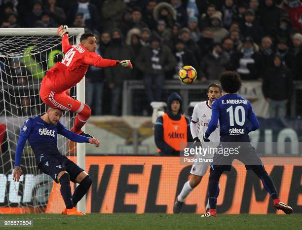 Milan goalkeeper Gianluigi Donnarumma competes for the ball with Sergej Milinkovic of SS Lazio during the TIM Cup match between SS Lazio and AC Milan...