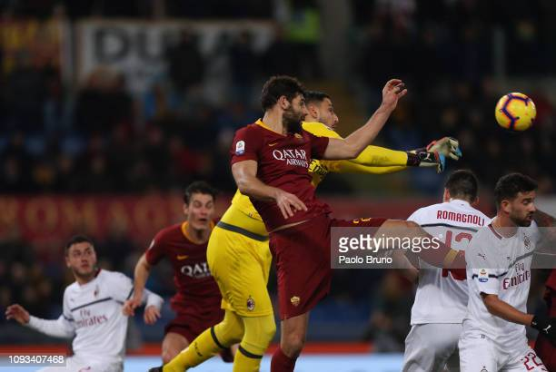 Milan goalkeeper Gianluigi Donnarumma in action Federico Fazio of AS Roma during the Serie A match between AS Roma and AC Milan at Stadio Olimpico on...