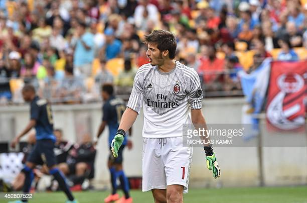 AC Milan goalkeeper Michael Agazzi reacts after conceding a fifth goal against Manchester City during a Champions Cup match at Heinz Field in...