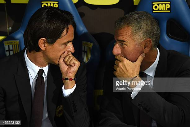 Milan head coach Filippo Inzaghi speaks with assistant coach Mauro Tassotti during the Serie A match between Parma FC and AC Milan at Stadio Ennio...