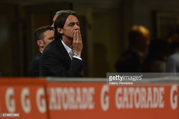 Milan head coach Filippo Inzaghi watchs the action from the stands after being sent off during the Serie A match between AC Milan and Torino FC at...