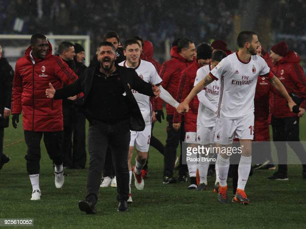 Milan head coach Gennaro Gattuso and Leonardo Bonucci with his teammates of AC Milan celebrate the victory after the TIM Cup match between SS Lazio...