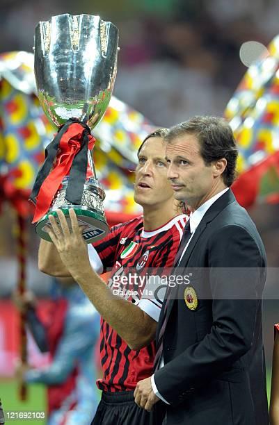 Milan head coach Massimiliano Allegr and Massimo Ambrosini celebrates after winning the Berlusconi Trophy during the Berlusconi Trophy match between...