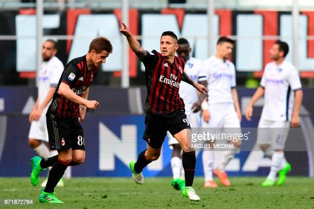 AC Milan Italian forward Gianluca Lapadula celebrates after scoring during the Italian Serie A football match AC Milan vs Empoli at the San Siro...