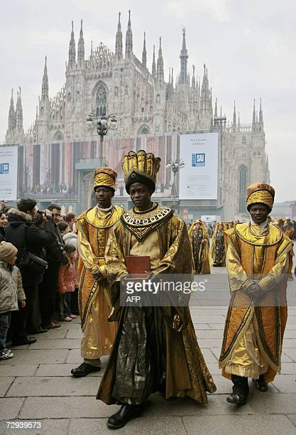 A man dressed as Balthasar on of the Three Wise Men marchs in Milan's Piazza Duomo during the annual Epiphany day parade 06 January 2007 This...