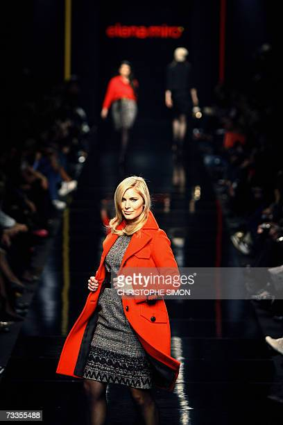 A model displays creation by fashion designer Elena Miro a ready to wear for large size during the Autumn/Winter Fashion Show in Milan 17 February...