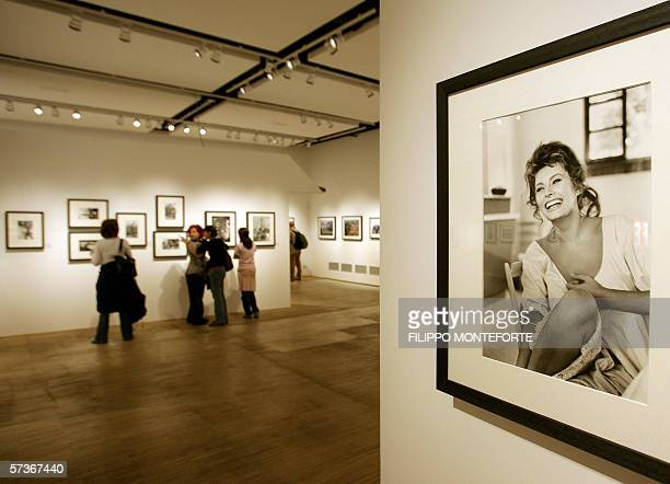 A visitor looks at pictures taken by some of the most notorious photographers from life magazine 19 April 2006 at an exhibition in Milan's...