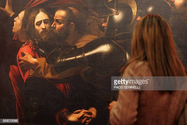 A woman looks at Italian painter Caravaggio's 'Capture of Christ' in Palazzo Reale during an exhibition called Caravaggio and Europe in Milan 14...
